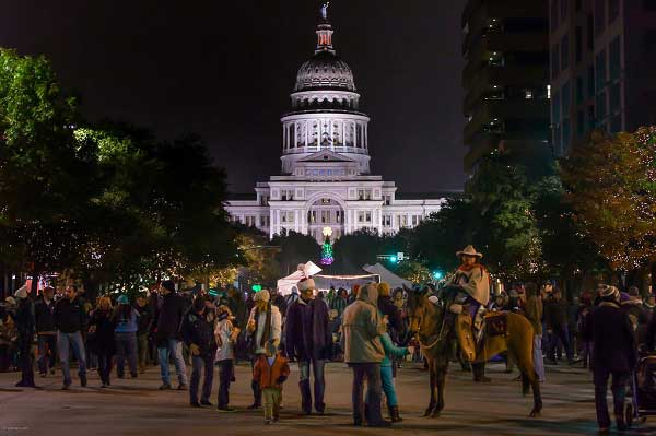 A crowd of people in front of the Austin, Texas, capital building during the Downtown Holiday Stroll event.